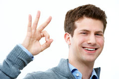 Okay. Handsome man showing sign of okay and smiling Stock Photo