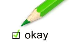 Okay. Check mark with the word okay and a green crayon Stock Image