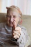 Okay. Hand of a senior person make OK gesture Royalty Free Stock Photo
