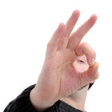 Okay (8.2mp Image). Man making an okay sign with his hands. Eye can be seen (out of focus) through his fingers. Shot with the Canon 20D royalty free stock photos