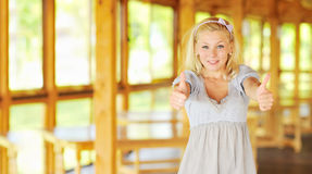 Okay - Beautiful woman porttrait showing thumbs up Royalty Free Stock Photography