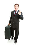 A-Okay Sign From Business Traveler. Business traveler gives the A-Okay sign.  Full body isolated on white background Royalty Free Stock Photography