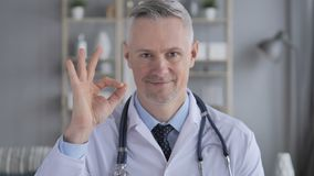 Okay Sign by Positive Doctor with Grey Hairs stock video footage
