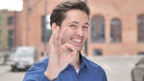 Okay Sign by Satisfied Young Man Standing Outdoor. 4k high quality, 4k high quality stock footage