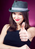 Okay or Thumb up & smiling beautiful young woman Stock Photography