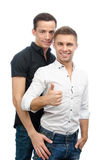Okay. Two sexy guys. Love and relationships. White background. Gay couple. Passion, sexuality and love. Two attractive young men. White background. Isolated Stock Photo