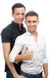Okay. Two sexy guys. Love and relationships. White background. Gay couple. Passion, sexuality and love. Two attractive young men. White background. Isolated Royalty Free Stock Photos
