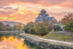 Okayama castle in autumn season in Okayama city, Japan. At sunset stock photos