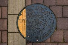 A manhole cover in Okayama, Japan royalty free illustration