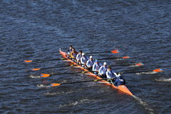 OKC Riversport Crew races in the Head of Charles Regatta Men`s Youth Eight. BOSTON - OCTOBER 23, 2016: OKC Riversport Crew races in the Head of Charles Regatta Royalty Free Stock Photo