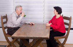 Okd couple at table Royalty Free Stock Photo