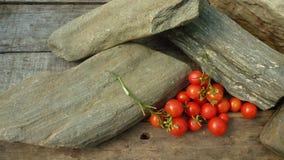 OkenTomato, cherry, red tomato, small spaeski tomato. Tomato for windows and small spaces on wooden table Royalty Free Stock Photos