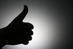 Okey!. It is the silhouette of the thumb against the light Stock Photo