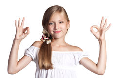 Okey. Little girl showing symbol ok with both hands Stock Photo