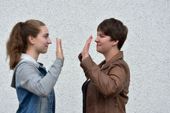 Okey dokey. Gesture,  ritual for greeting of two girlfriends Royalty Free Stock Photography