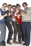 Okey dude!. Five nerdy guys in funny glasses, smiling and looking at camera with raised thumbs. Front view, white background. Whole body Royalty Free Stock Images