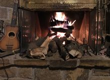 Okie Country Fireplace. Warm, cozy fire blazing in the fireplace in this log cabin out in the boonies near Shawnee, Oklahoma. For many families this is their stock images