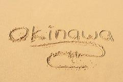 Okinawa en la arena imagen de archivo