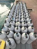 Scuba air tanks. Okinawa,Japan-June 25, 2017: Air tanks are ready for scuba diving royalty free stock photography