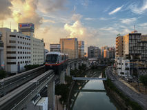 Okinawa Monorail : Yui Rail (Evening). Okinawa Monorail (Yui-Rail) is an only rail transport in Naha City, Okinawa, Japan. It's approaching Asahibashi station in stock images