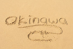 Okinawa in the Sand. A picture of the word Okinawa drawn in the sand Stock Image