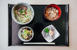 Okinawa Udon set with fried fish, fried rice  from top view. Japanese street food cuisine Okinawa Udon set with fried fish, fried rice  from top view Stock Photography