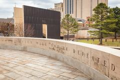 OKC National Memorial Wall and Quote. OKLAHOMA CITY, OKLAHOMA / USA - MARCH 31, 2018: Powerful words of, this nation will not be defeated, written in stone at Royalty Free Stock Photo