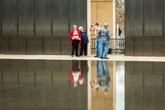 Older senior tourists walking at OKC Bombing Memorial. OKLAHOMA CITY, OKLAHOMA / USA - MARCH 31, 2018: Older senior tourists visit the Oklahoma City Bombing Royalty Free Stock Photography