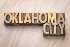Oklahoma City word abstract in letterpress wood type. Oklahoma City word abstract in vintage  letterpress wood type against grained wooden background Stock Photography