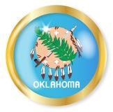 Oklahoma Flag Button. Oklahoma state flag button with a gold metal circular border over a white background Stock Image