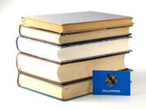 Oklahoma flag with pile of books  on white background Stock Photo