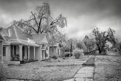 Oklahoma Ice Storm. Homes covered in ice from the January 2007 North American Ice Storm in black and white Royalty Free Stock Image