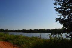 Oklahoma red dirt nature path by a lake Royalty Free Stock Photos