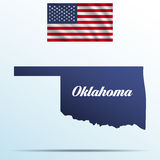 Oklahoma state with shadow with USA waving flag Royalty Free Stock Image