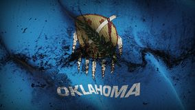 Oklahoma US State grunge dirty flag waving on wind. United States of America Oklahoma background fullscreen grease flag blowing on wind. Realistic filth fabric Stock Image