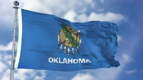 Oklahoma Waving Flag. Oklahoma U.S. state flag waving against clear blue sky, close up, isolated with clipping path mask luma channel, perfect for film, news Stock Photography