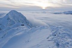 oklarhetsberg över solnedgångvinter Fotografering för Bildbyråer