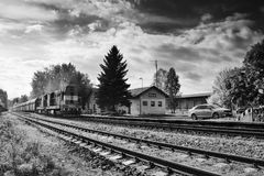 Okna, Ceska Lipa district, Czech republic - October 13, 2017: small train station with freight train on left in autumn Royalty Free Stock Photos
