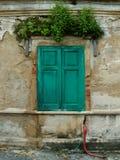 Okno na cement ścianie zdjęcie royalty free