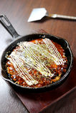Okonomiyaki japan food. In hot pan Royalty Free Stock Images