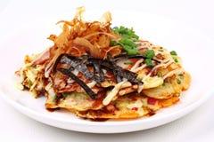 Okonomiyaki Japanese Cabbage Pancake Recipe. Okonomiyaki Japanese Cabbage Pancake Recipe is fried mixed vegetable flour with meat topped sweet sauce ,mayonnaise Royalty Free Stock Images