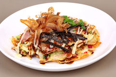 Okonomiyaki Japanese Cabbage Pancake Recipe. Okonomiyaki Japanese Cabbage Pancake Recipe is fried mixed vegetable flour with meat topped sweet sauce ,mayonnaise Royalty Free Stock Photography