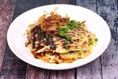Okonomiyaki Japanese Cabbage Pancake Recipe. Okonomiyaki Japanese Cabbage Pancake Recipe is fried mixed vegetable flour with meat topped sweet sauce ,mayonnaise Stock Photos