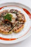 Okonomiyaki is a Japanese savoury pancake containing a variety of ingredients.  Royalty Free Stock Images