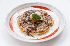 Okonomiyaki is a Japanese savoury pancake containing a variety of ingredients.  Royalty Free Stock Photo