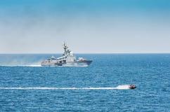 Okręt wojenny i hydrocycle w morzu fotografia royalty free