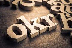 OKR Abbreviation Objective Key Results. OKR wood alphabet, abbreviation of Objective Key Results stock photo