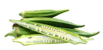 Okra Abelmoschus. Whole and chopped okra Abelmoschus isolated on white background Stock Images
