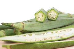 Okra bär frukt Abelmoschus esculentus som isoleras på vita Backgroun Royaltyfria Bilder