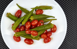 Okra cooked with red tomatoes Stock Photography